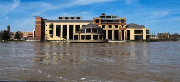The Grand Rapids Public Museum sits just above the Grand River during floods in April 2013.