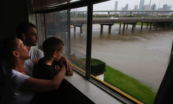 Stacy Stanley, Robert, and their 6-year-old son Zane watch the high water level on White Oak Drive at the Taylor Street underpass as floodwaters rise from the White Oak Bayou after heavy rains hit the Houston area on Saturday, April 18, 2009. The Stanley'