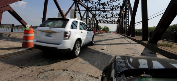 "In this Sept. 11, 2013 file photo, vehicles drive on the 130th St. bridge over the Little Calumet River in Chicago that was classified as both ""structurally deficient"" and ""fracture critical"" in federal data for 2012."