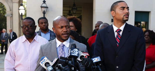 Attorneys for Walter Scott's family, L. Chris Stewart, center, and Justin T. Bamberg, right, answers questions during a news conference after a bail hearing for former North Charleston police officer Michael Slager, Sept. 10, 2015, in Charleston, S.C.