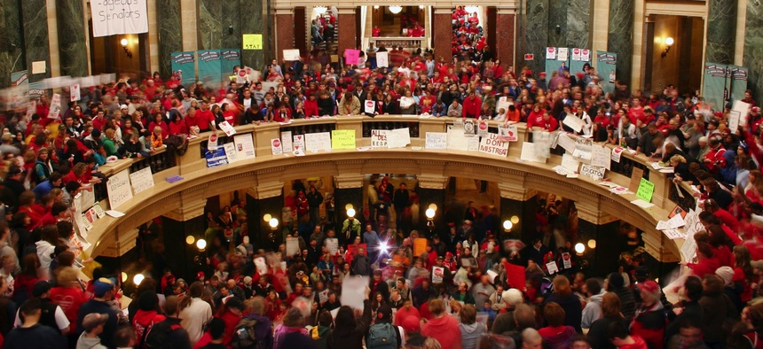 Thousands fill the Rotunda at the Wisconsin State Capitol on Feb. 17, 2011, to protest Gov. Scott Walker's plan to eliminate public workers' collective bargaining rights.