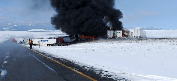 Smoke rises following the aftermath of a chain-reaction crash along Interstate 80 near Laramie, Wyo., Monday, April 20, 2015.