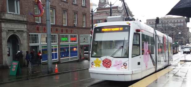 A streetcar vehicle travels along Jackson Street in Seattle.