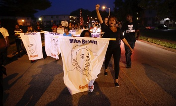 Protesters march down Canfield Drive in August near where Michael Brown was killed by a police officer in Ferguson, Missouri.