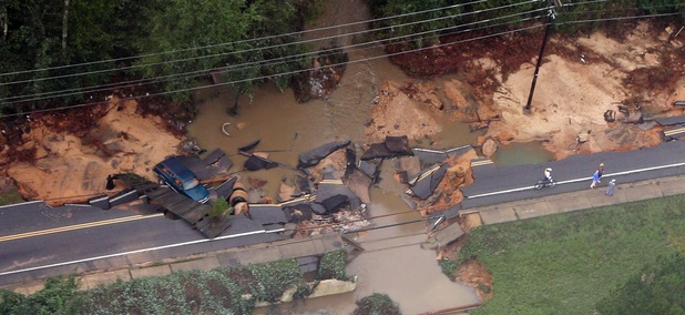 A truck rests off a washed out road outside of Columbia, S.C., after a week of steady rain last fall associated with Hurricane Joaquin.