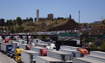 Trucks carry goods and possibly contraband north into Nogales, Arizona.