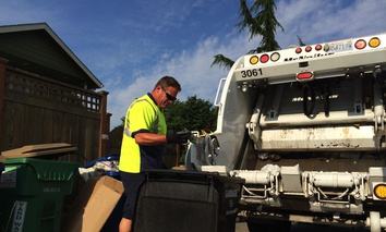 Seattle Waste Management digs through a resident's trash looking for food scraps that should've been placed with other compostable material instead.