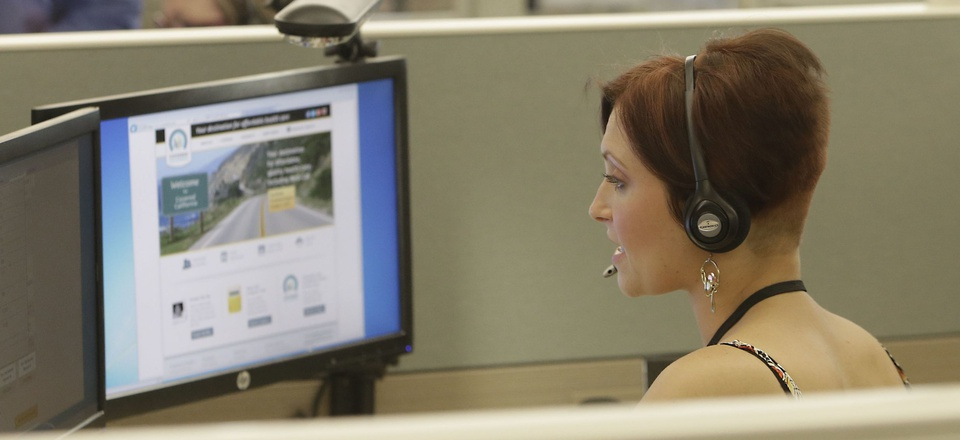 "Gina Macaluso, an employee of Covered California, the state's health insurance exchange, provides information at a call center. California, Kentucky and Vermont had ""significant"" cybersecurity weakesses in their exchanges, federal investigators found."