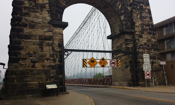 The Wheeling Suspension Bridge, connecting Wheeling, W.Va., with Wheeling Island in the Ohio River.