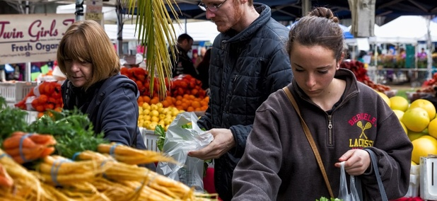 Shoppers at an Oakland, California farmers market.