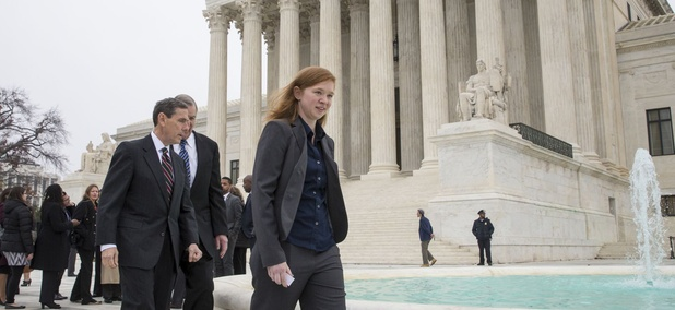 Abigail Fisher, who challenged the use of race in college admissions, walks with lawyers Edward Blum, left, and Bert Rein, rear, outside the Supreme Court in Washington, Wednesday, Dec. 9, 2015, following oral arguments.
