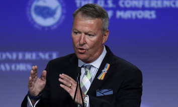 Orlando Mayor Buddy Dyer addresses the the U.S. Conference of Mayors in Indianapolis, Sunday, June 26, 2016.