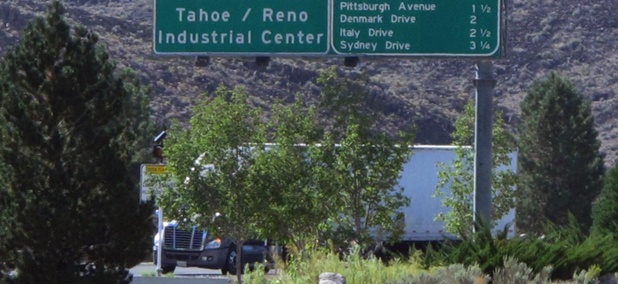 A truck leaves the Tahoe Reno Industrial Center, home to the recently opened Tesla Gigafactory, where ZIP code problems complicate sales and use tax reporting.