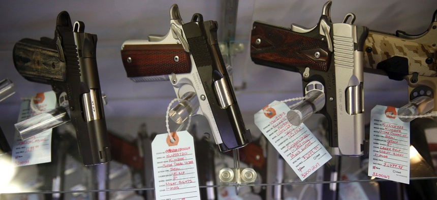 Handguns in a display case at Metro Shooting Supplies, in Bridgeton, Mo.
