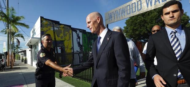 Florida Gov. Rick Scott after a news conference in Wynwood on Monday, Sept. 19, 2016.
