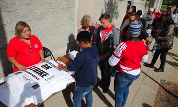 Chicago Teachers Union members pick up strike material outside the union's strike headquarters.