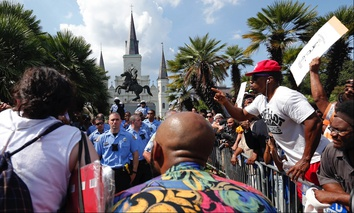 New Orleans police guard a statue of Andrew Jackson, in Jackson Square, during a protest organized by Take 'Em Down NOLA on Sept. 24.