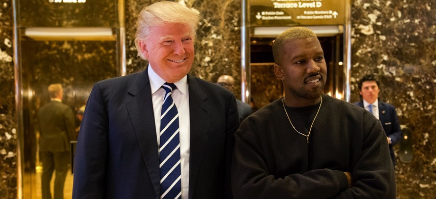 President-elect Donald Trump, left, and Kanye West pose for a picture in the lobby of Trump Tower in New York, Tuesday, Dec. 13, 2016.