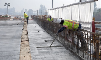 Workers on the Fresno River Viaduct that will carry the future California High Speed Rail corridor through the Fresno area.