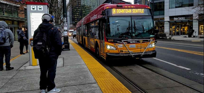 A hybrid-electric RapidRide bus, travels along Westlake Avenue in Seattle.