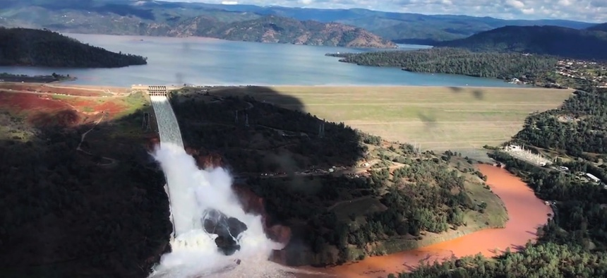 Water flowing over a spillway of the Oroville Dam in Oroville, Calif.