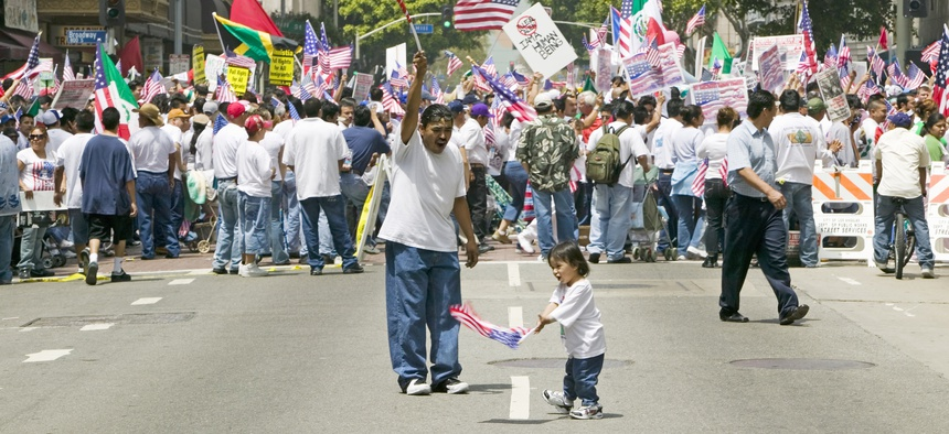 A father and daughter at a protest in solidarity with undocumented immigrants in Los Angeles, California.