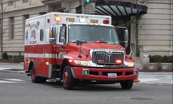 An ambulance travels through Washington, D.C.'s Dupont Circle neighborhood.