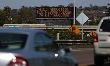 Drivers pass a display showing an Amber Alert, asking motorists to be on the lookout for a specific vehicle, on Aug. 6, 2013, in San Diego.