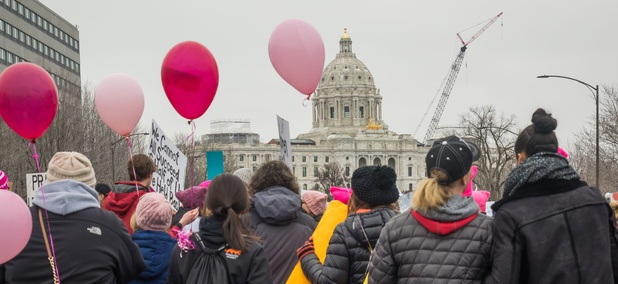 A group of people with pink balloons gather at the state capitol during the Women's March in St. Paul, Minnesota, on January, 21, 2017.