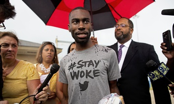Black Lives Matter activist DeRay Mckesson talks to the media after his release from the Baton Rouge jail in Baton Rouge, La.