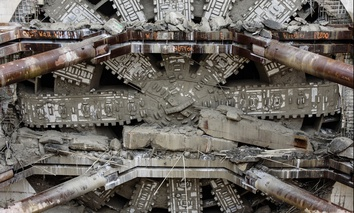 Bertha, which launched as the world's largest tunnel-boring machine, crashes through its concrete finish line on April 4.