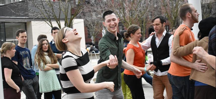 People dance in downtown Portland, Oregon.