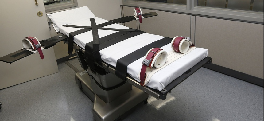 This Oct. 9, 2014, file photo shows the gurney in the the execution chamber at the Oklahoma State Penitentiary in McAlester, Okla.