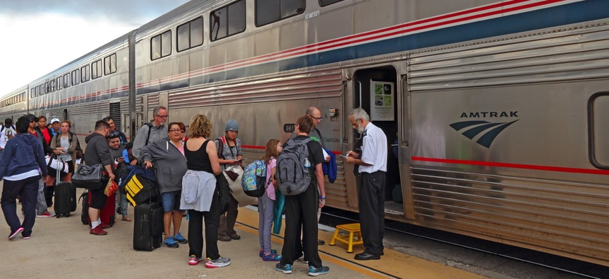 Passengers board an Amtrak from Albuquerque, New Mexico to Los Angeles.