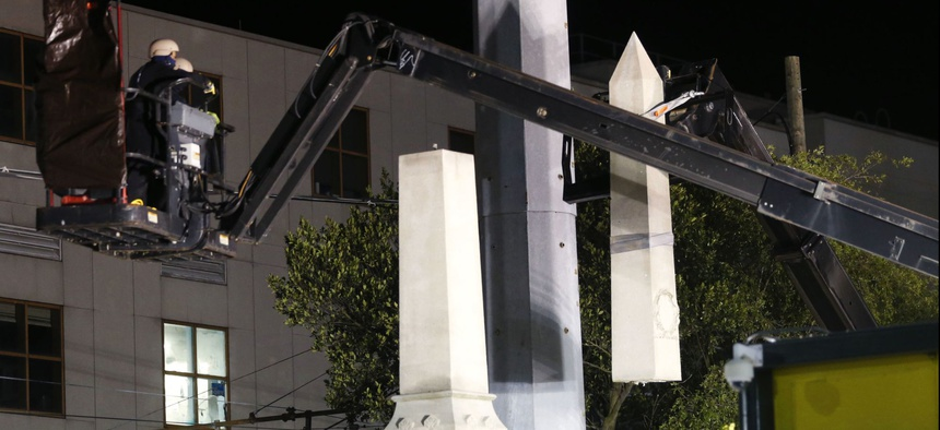 Workers dismantle the Liberty Place monument Monday, April 24, 2017, which commemorates whites who tried to topple a biracial post-Civil War government, in New Orleans.