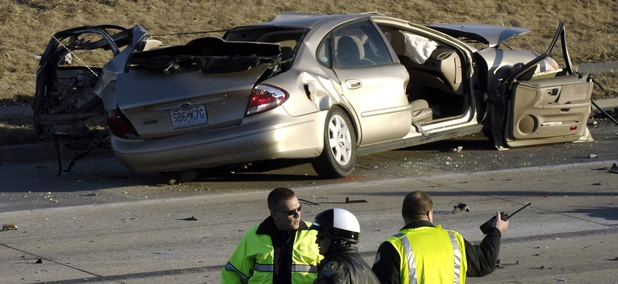 Columbia, Mo., police inspect the scene of a fatal two-vehicle crash on Feb. 9, 2009, where one of the drivers wasn't wearing a seatbelt.