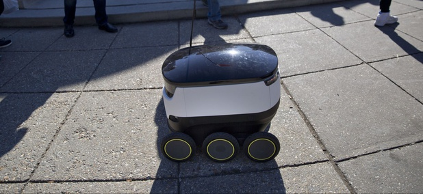 Six-wheeled ground delivery robot, from Estonia-based Starship Technologies, share the sidewalk with pedestrians at Dupont Circle in Washington, D.C.