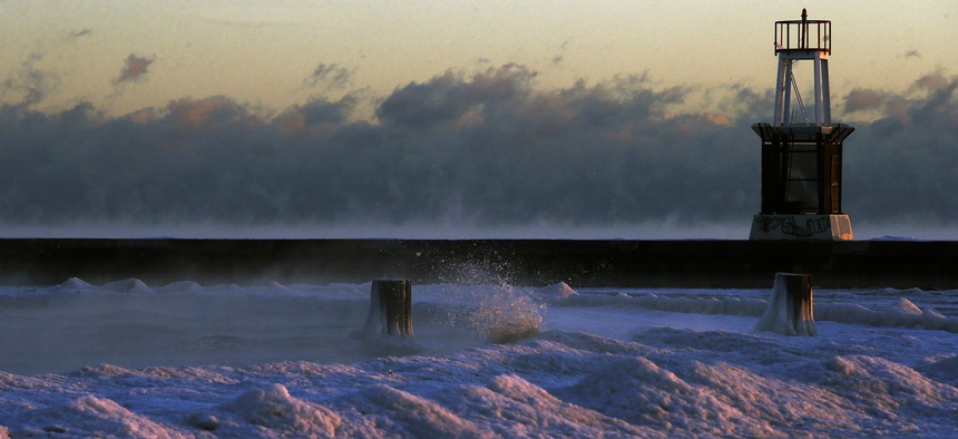 Steam rises up on the surface of Lake Michigan at sunrise, Thursday, Dec. 15, 2016, in Chicago.
