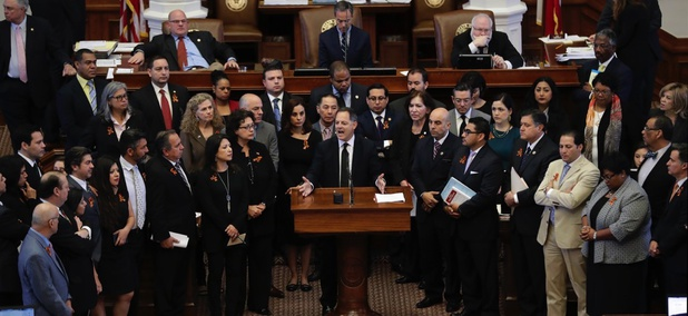 Democratic lawmakers in Texas threaten legal action after Republicans forced through a law that would see sheriffs jailed for failure to comply with federal immigration enforcement.