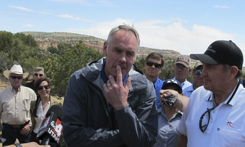 Interior Secretary Ryan Zinke, center, is joined by Utah Gov. Gary Herbert, right, during a press conference Monday, May 8, 2017, at the Butler Wash trailhead within Bears Ears National Monument near Blanding, Utah.