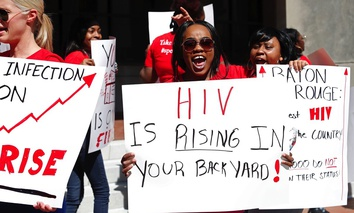 Community advocates in Baton Rouge protest outside of City Hall against the defunding of two local community HIV clinics in April 2017.