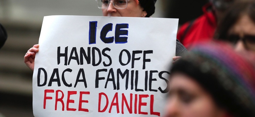 A protester holds a sign during a demonstration protesting the arrest of Dreamer Daniel Ramirez Medina, who was later released, in front of the federal courthouse in Seattle in February.