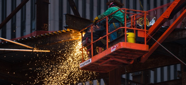orkers on the construction site. Metal welding work at the construction site in Lower Manhattan. Sparks from welding work.