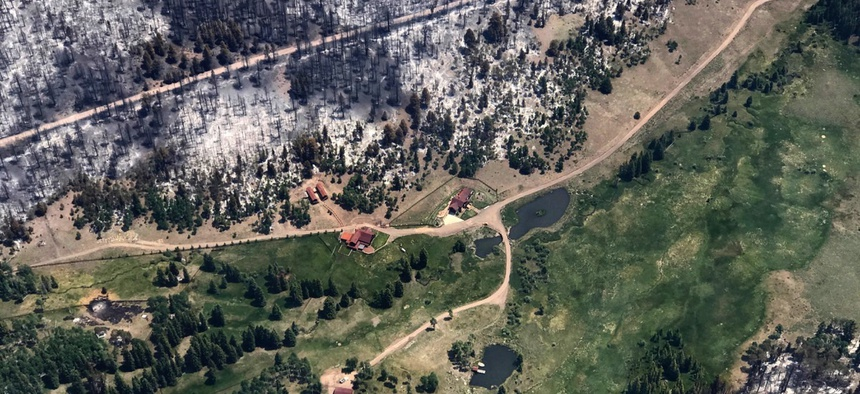 The nation's largest wildfire has forced more than 1,500 people from their homes and cabins in a southern Utah mountain area.