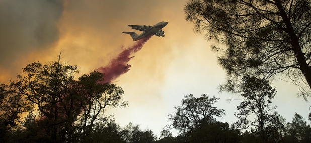 A plane drops retardant while battling a wildfire near Oroville, Calif., on Saturday, July 8, 2017.