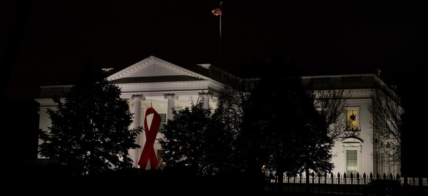 A red ribbon is displayed on the North Portico of the White House to recognize World AIDS Day in December 2015.