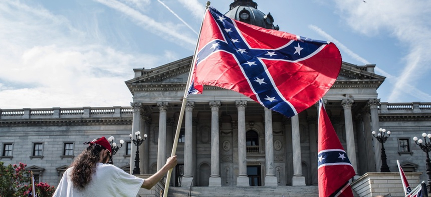Protesters contest the Confederate battle flag's removal from the grounds of the Statehouse in Columbia, S.C.