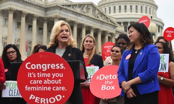 Rep. Carolyn Maloney, D-N.Y., front left, with Rep. Grace Meng, D-N.Y., right, speaks to supporters during a women's health rally hosted by Women's Voices for the Earth on the grounds of the Capitol in May 2017.