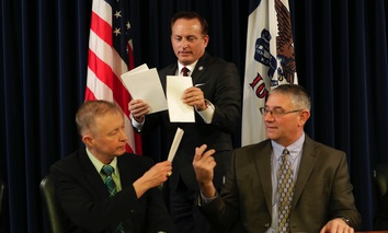 Iowa Sec. of State Paul Pate, center, collects ballots from Iowa electors Alan Braun, of Norwalk, Iowa, left, and Don Kass, of Remsen, Iowa, right, during Iowa's Electoral College vote in 2016.