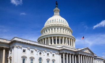 The United States Capitol building in Washington, DC in summer, blue sky.